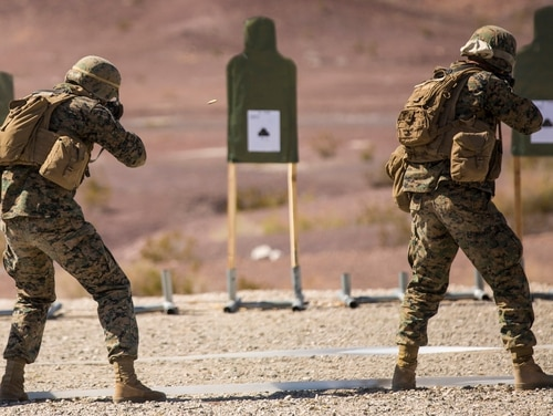 Marines with Marine Wing Support Squadron 371, based out of Marine Corps Air Station Yuma, perform shooting drills with their M16A4 service rifles during a squadron field exercise in 2016 (Pfc. George Melendez)