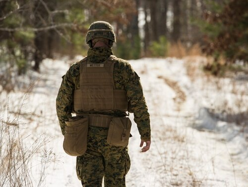 Then-Staff Sgt. Kyle Wetter, platoon sergeant with Lima Company, 3rd Battalion, 2nd Marine Regiment, walks toward the improvised bangalore impact zone during a Deployment for Training exercise at Fort A.P. Hill, Virginia., Jan 28, 2016. ( Lance Cpl. Samuel Guerra/Marine Corps)