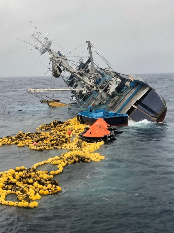 Fishing nets, life rafts, and debris from the 160-foot Ecuadorian fishing vessel Marujita float behind the capsizing vessel approximately 336 nautical miles southeast of Clipperton Island on Wednesday. (Coast Guard)