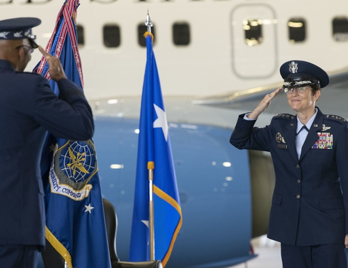 Gen. Jacqueline Van Ovost salutes Air Force Chief of Staff Gen. Charles