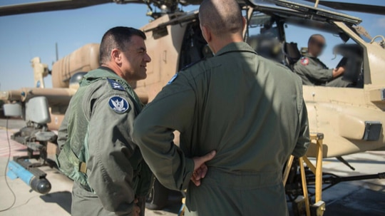 Maj. Gen Amikam Norkin, commander of the Israeli Air Force, oversees the return of the first Apaches to operational duty after they were grounded for nearly three months. (Courtesy of the Israel Defense Forces)