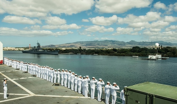 150525-N-TQ272-044 JOINT BASE PEARL HARBOR-HICKAM, Hawaii (May 25, 2015) - Sailors aboard the Military Sealift Command hospital ship USNS Mercy (T-AH 19) render honors as the ship passes the USS Arizona Memorial and the Battleship Missouri Memorial during Pacific Partnership 2015. Now in its 10th iteration, Pacific Partnership is the largest annual multilateral humanitarian assistance and disaster relief preparedness mission conducted in the Indo-Asia-Pacific region. In addition to training for crisis conditions, Pacific Partnership has provided medical care to approximately 270,000 patients and veterinary services to more than 38,000 animals. Additionally, Pacific Partnership has provided critical infrastructure development to host nations through the completion of more than 180 engineering projects. (U.S. Navy photo by Mass Communication Specialist 2nd Class Mark El-Rayes/Released)