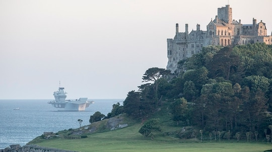 Britain's new aircraft carrier HMS Queen Elizabeth is seen anchored in Mount's Bay on June 11, 2018 in Penzance, England. HMS Queen Elizabeth, the First of Class Aircraft Carrier, and the largest and most powerful surface warship ever built for the Royal Navy, is currently undertaking sea trials ahead of receiving the RAF's £9 billion stealth fighter the F-35 Lightning IIs later this summer. (Photo by Matt Cardy/Getty Images)