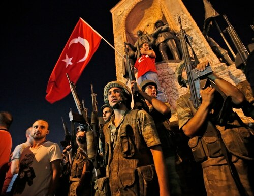 Turkish soldiers secure the area, as supporters of Turkey's President Recep Tayyip Erdogan protest in Istanbul's Taksim square, early Saturday, July 16, 2016. Turkey's armed forces said it