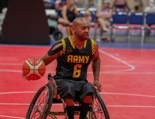 Spc. Brent Garlic competes in wheelchair basketball at the 2019 Warrior Games. Photo by Pfc. Dominique Dixon.