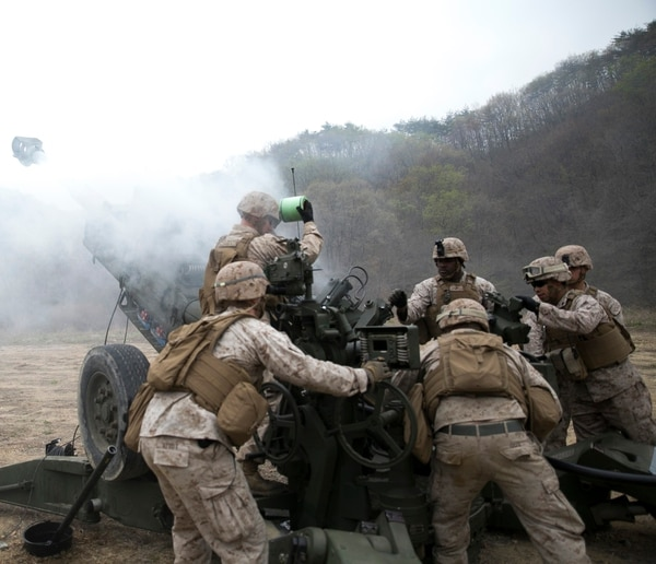 Artillery Marines fire off rounds from M777A2 lightweight 155 mm howitzers April 3 at Su Seung-ri Range in the Republic of Korea as part of Exercise Ssang Yong 2014. The Marines shot off eight rounds during the calibration portion of the live-fire, followed by another 40 rounds in succession. Ssang Yong is an exercise that showcases the amphibious and expeditionary capabilities of the ROK and U.S. forces as well as the maturity of the relationship between the two nations. The Marines are with Golf Battery, 2nd Battalion, 11th Marine Regiment currently assigned to Battalion Landing Team 2nd Bn., 5th Marines, 31st Marine Expeditionary Unit, III Marine Expeditionary Force. (U.S. Marine Corps photo by Cpl. Lena Wakayama/Released)