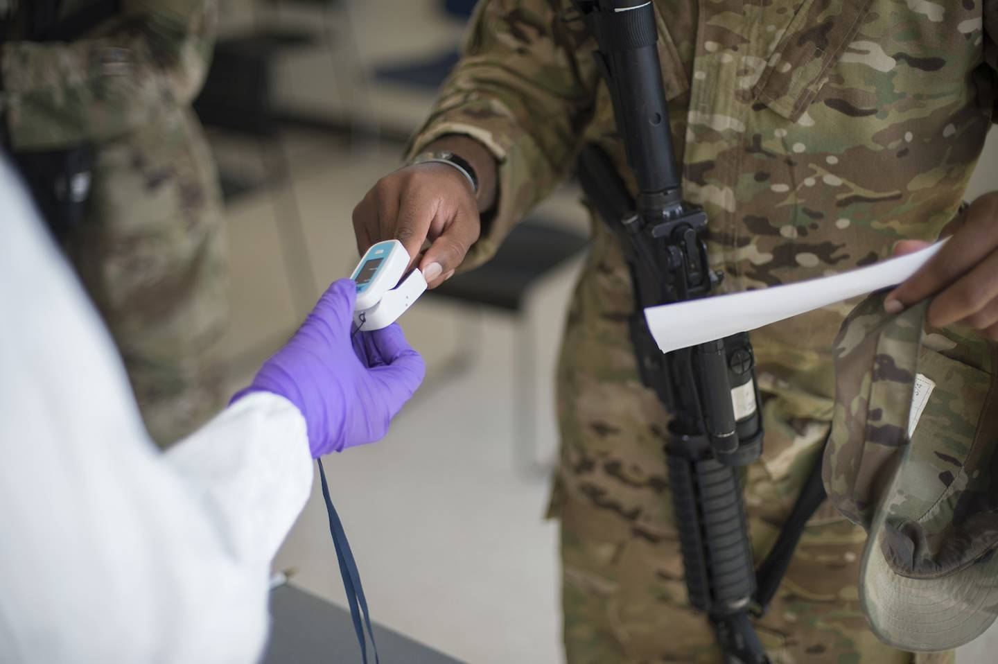 Soldiers attached to the Texas Army National Guard's 36th Infantry Division and 272th Engineer Company receive a COVID-19 IgG, IgM antigen test at Camp Swift in Bastrop, Texas, on June 9, 2020.