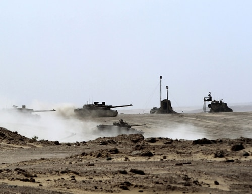 UAE tanks drive during joint military maneuvers with the French Army in the desert of Abu Dhabi on May 2, 2012. Saab says a new camera can be used on main battle tanks, among other vehicular platforms. (Karim Sahib/AFP via Getty Images)