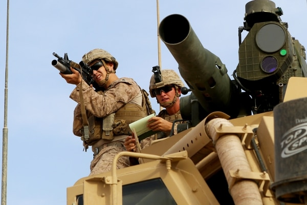 U.S. Marine Corps Cpl. Spencer Knudson, left, and Sgt. Mark Herd, both vehicle commanders with Weapons Company, 1st Battalion, 7th Marine Regiment, survey the landscape during a Combined Anti-Armor Team patrol at Al Asad Air Base, Iraq, Oct. 23. The Marines patrolled the area of operation to determine possible fields of fire. The Marines are providing security for Al Asad, which is one of five sites in Iraq where coalition members are training Iraqi Security Forces to defeat the Islamic State of Iraq and the Levant. (U.S. Marine Corps photo by Sgt. Owen Kimbrel/Released)