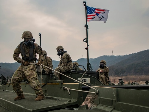 U.S. Army soldiers maneuver and connect a section of an Improved Ribbon Bridge during a rafting exercise on Namhan River, South Korea, Feb. 27, 2019. (Spc. Adeline Witherspoon/Army)