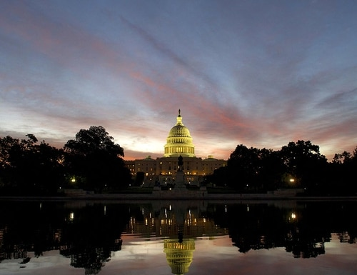 The US Capitol dome is seen at sunrise over Washington, D.C., Sept. 25, 2013. (Saul Loeb/AFP/Getty Images)