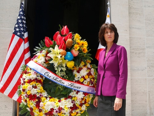 Denise Natali, U.S. Assistant Secretary Bureau of Conflict and Stabilization Operations, stands beside a wreath during a wreath-laying ceremony for the more than 17,000 US troops killed during WWII at the American Cemetery Tuesday, June 4, 2019, in suburban Taguig city east of Manila, Philippines. (Bullit Marquez/AP)