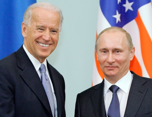In this March 10, 2011, file photo, then-Vice President Joe Biden, left, shakes hands with Russian Prime Minister Vladimir Putin in Moscow. (RIA Novosti, Alexei Druzhinin/Pool via AP)