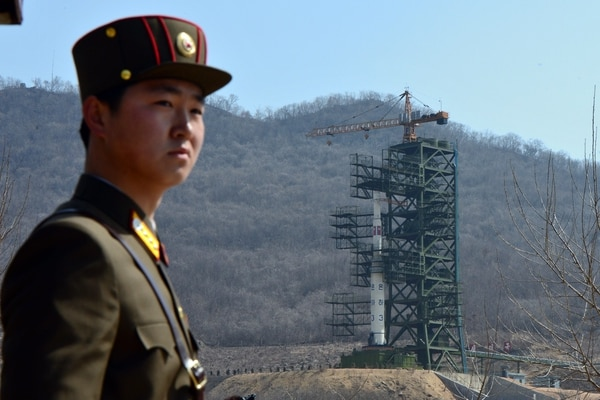 A North Korean soldier stands guard in front of the Unha-3 rocket at at the Sohae Satellite Launch Station in Tongchang-Ri on April 8, 2012. North Korea has confirmed their intention to launch the rocket next week despite international condemnations. (Pedro Ugarte/AFP via Getty Images)