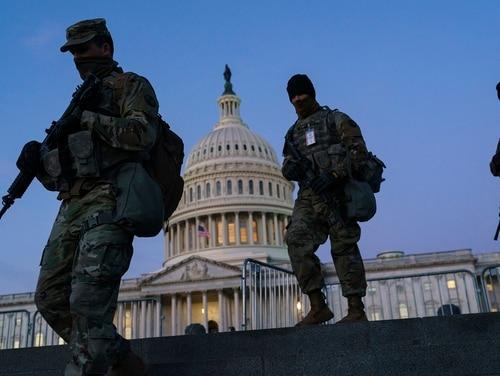 National Guard troops patrol outside the Capitol building on Jan. 19, 2021. (J. Scott Applewhite/AP)