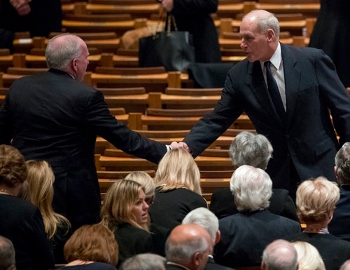 Former CIA Director John Brennan, left, shakes hands with President Donald Trump's Chief of Staff John Kelly, right, before a State Funeral for former President George H.W. Bush at the National Cathedral on Wednesday in Washington. (Andrew Harnik/Pool, AP)