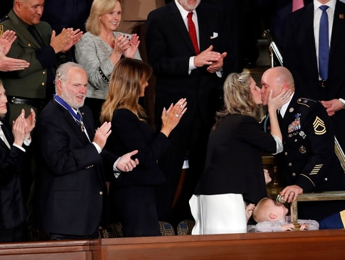 Amy Williams kisses her husband Sgt. 1st Class Townsend Williams after he surprised her by appearing at the State of the Union address by President Donald Trump in a joint session of Congress on Capitol Hill on Feb. 4, 2020. (J. Scott Applewhite/AP)