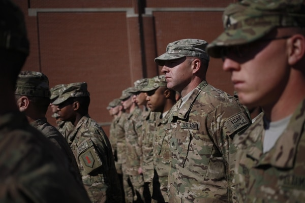 FORT KNOX, KY - FEBRUARY 27: Soldiers from the U.S. Army's 3rd Brigade Combat Team, 1st Infantry Division, stand in formation before participating in a homecoming ceremony in the Natcher Physical Fitness Center on Fort Knox on Thursday, February 27, 2014 in Fort Knox, Ky. About 100 soldiers returned to Fort Knox after a nine-month combat deployment conducting village stability operations and working alongside Afghan military and police forces. (Photo by Luke Sharrett/Getty Images)