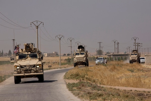 U.S. armored vehicles travel in a joint patrol of the safe zone between Syria and the Turkish border with the Tal Abyad Military Council Tal Abyad, Syria, Friday, Sept. 6, 2019. (Maya Alleruzzo/AP)