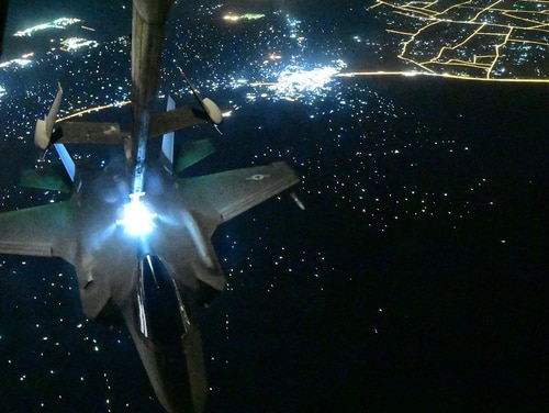 A U.S. Air Force F-35A Lightning II assigned to the 4th Expeditionary Fighter Squadron, Al Dhafra Air Base, United Arab Emirates, receives fuel from a KC-10 Extender, above an undisclosed location Sept. 10. (Staff Sgt. Chris Drzazgowski/Air Force)