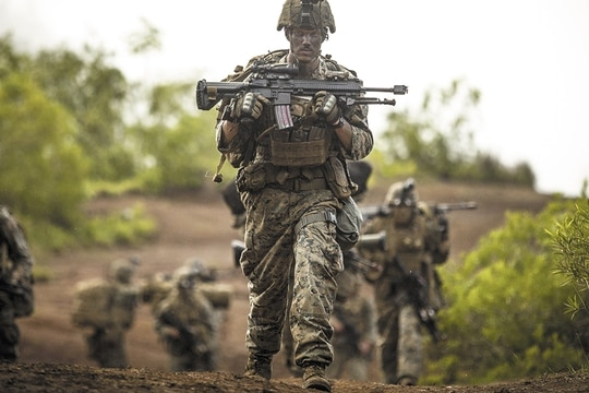 The decision to drop down to a 12-man squad appears in part driven by manpower concerns and the need to expand the Corps' capability in other areas like cyber. (Cpl. Aaron Patterson/Marine Corps)