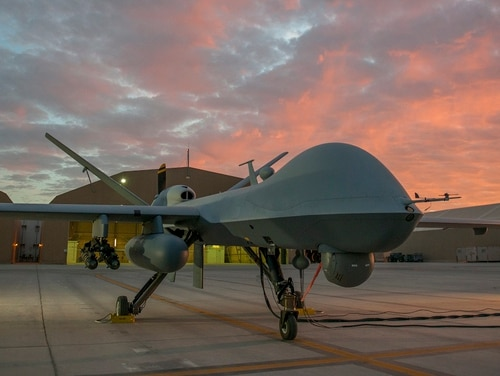 An MQ-9 Reaper equipped with an extended range modification from the 62nd Expeditionary Reconnaissance Squadron sits on the ramp at Kandahar Airfield, Afghanistan, Dec. 6, 2015. (Tech. Sgt. Robert Cloys/Air Force)