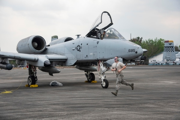 U.S. Air Force Staff Sgt. Robert Fair assists multiple A-10 Thunderbolt II aircraft on the flight line at Clark Air Base in the Philippines on Friday in preparation for Exercise Balikatan. Fair is a crew chief with the 25th Fighter Squadron out of South Korea's Osan Air Base. (Senior Airman Sadie Colbert/Air Force)