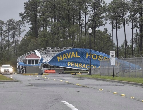 The Pensacola Naval Hospital banner acted as a sail as high winds from Hurricane Sally tore down its support scaffolding on Thursday, Sept. 17, 2020. (Naval Hospital, Pensacola photo)
