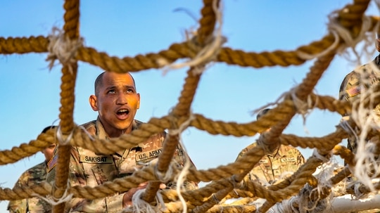 A soldier with the Guam National Guard assigned to the Multinational Force and Observers prepares to climb an obstacle during the MFO Force Skills Competition in South Camp, Egypt, Feb. 18, 2020. (Staff Sgt. Eliverto Larios/DoD)