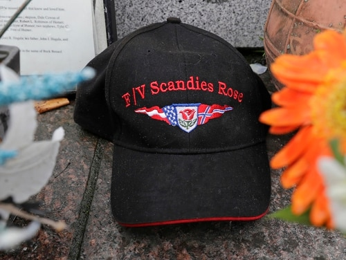 A ball cap with the name of the crab fishing boat Scandies Rose rests at the Seattle Fishermen's Memorial on Thursday in Seattle. The search for five crew members of the Scandies Rose in Alaska has been suspended, the U.S. Coast Guard said after two other crew members of the vessel were rescued after the 130-foot crab fishing boat from Dutch Harbor, Alaska, sank on New Year's Eve. (Ted S. Warren/AP)