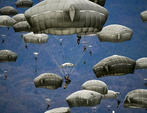 U.S. Army and Italian Army paratroopers conduct airborne operation after exiting a U.S. Air Force C-130 Hercules aircraft at Juliet Drop Zone, Pordenone, Italy, Dec. 10, 2020. (Paolo Bovo/Army)