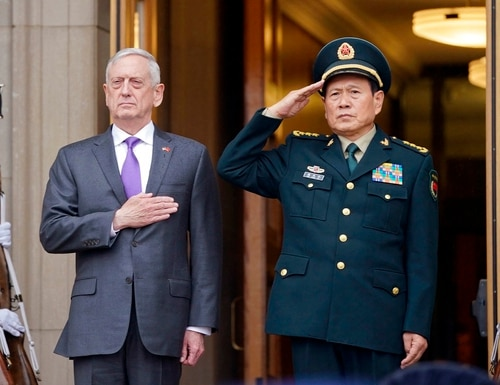 Defense Secretary Jim Mattis and Chinese Minister of Defense General Wei Fenghe, stand as the national anthems are played during an welcome ceremony at the Pentagon on Friday. (Pablo Martinez Monsivais/AP)