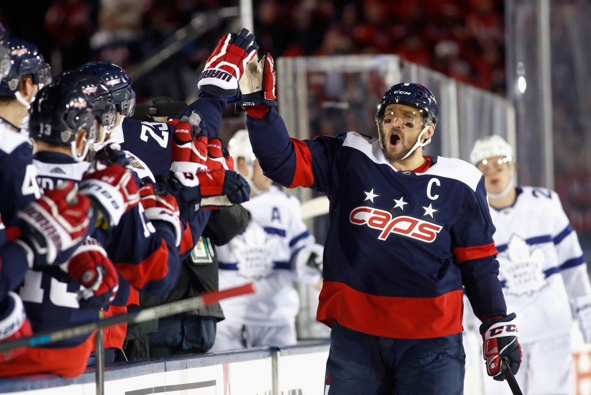 Capitals captain Alex Ovechkin celebrates after putting the home team ahead  early. The game was the first ever outdoor NHL game on a military  installation. f382951f5d00