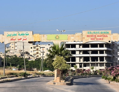 A picture taken on June 9, 2017, shows the main entrance to the city of Afrin, along Syria's northern border with Turkey. (George Ourfalian/AFP/Getty Images)