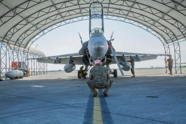 An aviation technician chief with Marine All-Weather Fighter Attack Squadron (VMFA) 242 oversees his Marines as they finish maintaining an F/A-18D Hornet in Iwakuni, Japan. (Lance Cpl. Gabriela Garcia-Herrera/Marine Corps)