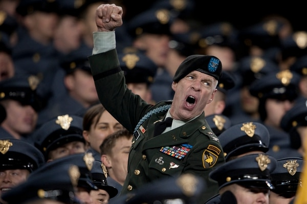 091212-N-0696M-821 An Army Soldier celebrates during the 110th playing of the Army-Navy football game at Lincoln Financial Field, Philadelphia, Pa., Dec. 12, 2009. (DoD photo by Mass Communication Specialist 1st Class Chad J. McNeeley/Released)