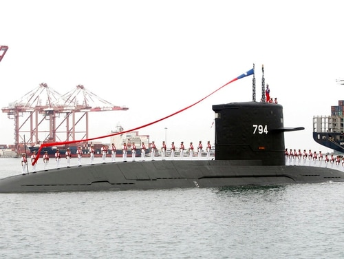Taiwanese sailors salute from a Zwaardvis-class submarine during a groundbreaking ceremony for the island's naval submarine factory in Kaohsiung, southern Taiwan, on Thursday. (Chiang Ying-ying/AP)