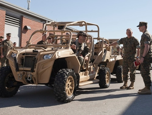 Commandant Gen. Robert Neller discusses the MRZR Tactical Warfighter all-terrain vehicle at Stone Bay, Camp Lejeune, North Carolina, in March 2016. (Cpl. Samantha K. Draughon/Marine Corps)