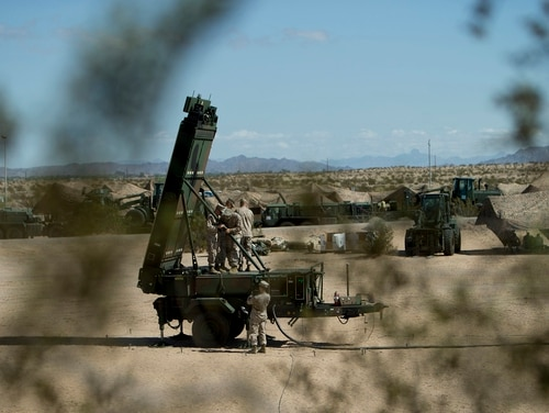 Marine Corps radar technicians with the Early Warning Control Crew install the arms of the Ground/Air Task Oriented Radar during a Weapons and Tactics Instructor Course exercise, at Cannon Air Defense Complex (P111), Yuma, Ariz. (Cpl. Summer Dowding/Marine Corps)