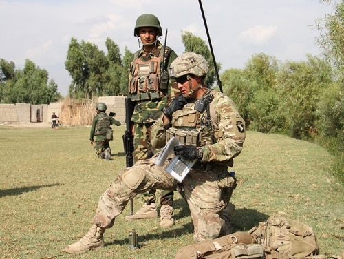 A 101st Airborne Division soldier assigned to Train Advise Assist Command-East communicates via radio as Afghan National Army troops during a partnered patrol in Laghman province Sept. 23, 2015. (Capt. Jarrod Morris/Army)