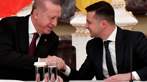 Ukrainian President Volodymyr Zelenskyy, right, and his Turkish counterpart Recep Tayyip Erdogan shake hands during a joint news conference following their meeting in Kyiv on Feb. 3, 2020. (Sergei Supinsky/AFP via Getty Images)