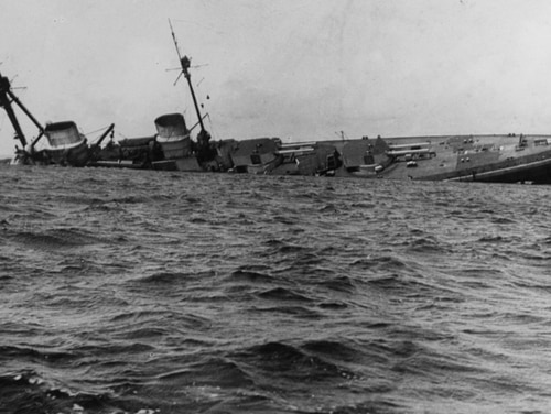 The German battle cruiser Derfflinger four minutes before finally sinking at 1445, 21 June 1919. (Courtesy of Senior Chief Hull Maintenance Technician H. E. Manlove, 1975, now in the collections of U.S. Naval History and Heritage Command)