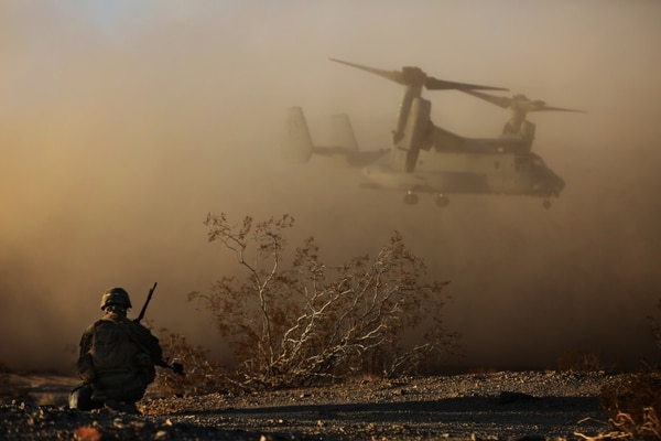 First Lt. Joseph Carroll looks on as an MV-22B Osprey takes off during an air assault an Urbanized Terrain town during the Marine Corps Combat Readiness Evaluation Exercise, Jan.16, 2015. (Lance Cpl. Julio McGraw/Marine Corps)