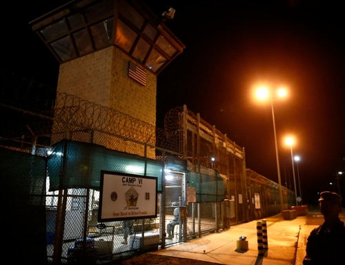 In this Nov. 20, 2013, file photo, reviewed by the U.S. military, the entrance to Camp VI detention facility is guarded at Guantanamo Bay Naval Base, Cuba. (Charles Dharapak/AP)