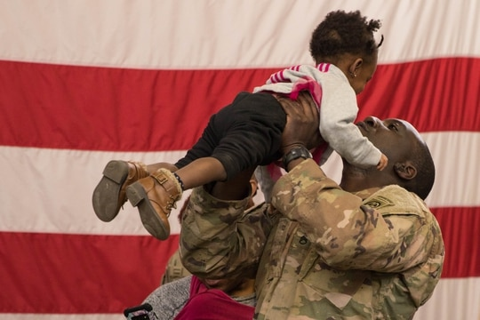 Dozens of friends and family gathered to welcome home 82nd Airborne Division Paratroopers in February. (Army)