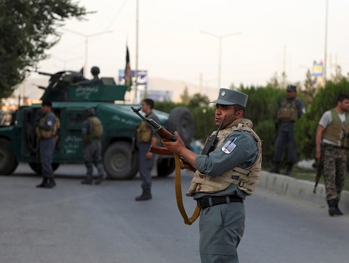 Afghan security personnel secure the site of an attack in Kabul, Afghanistan, on July 28, 2019. (Rahmat Gul/AP)