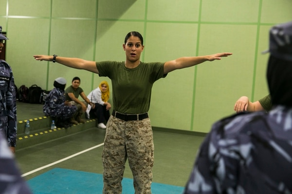 QATAR (Aug 18, 2015) U.S. Marine Cpl. Justine Woodend demonstrates the Marine Corps Martial Arts Program to members of the Qatari Internal Security Forces Female VIP Protection Unit during a Subject Matter Expert Exchange in Qatar. Woodend is a motor transportation operator with Combat Logistics Battalion 15, 15th Marine Expeditionary Unit and a member of the Female Partner Force Engagement Team. The FPFET was comprised of U.S. Marines with the 15th Marine Expeditionary Unit as well as Soldiers and Sailors with Special Operations Command Central-Forward and Joint Special Operations Task Force-Arabian Peninsula. During the SMEE they covered medical care, marksmanship, and personal security detail strategies. (U.S. Marine Corps photo by Cpl. Anna Albrecht/ Released)