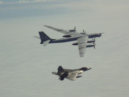 An F-22A Raptor from NORAD intercepts a Russian Tu-95
