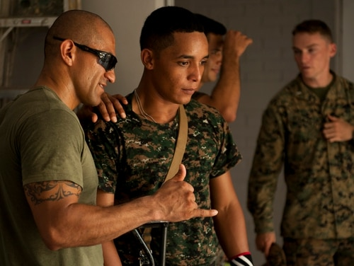 A Marines offers feedback to a Guatemalan marine who is learning how to teach room clearing to his juniors. The Marines deploy to Puerto Barrios, Guatemala for six months at a time to work with the members of the new force tasked with fighting drug traffickers. Mike Morones/Staff