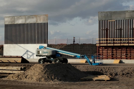 In this Nov. 7, 2019, photo, the first panels of levee border wall are seen at a construction site along the U.S.-Mexico border, in Donna, Texas. The Trump administration said Tuesday, Feb. 18, 2020, that it will waive federal contracting laws to speed construction of the border wall with Mexico. (Eric Gay/AP)